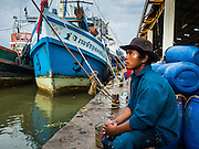 01 OCTOBER 2015 - MAHACHAI, SAMUT SAKHON, THAILAND: A crewman on a fishing trawler in Mahachai, one of Thailand's largest fishing ports. Thailand's fishing industry had been facing an October deadline from the European Union to address issues related to overfishing and labor practices. Failure to adequately address the issues could have resulted in a ban on Thai exports to the EU. In September Thai officials announced that they had secured an extension of the deadline. Officials did not say how much extra time they had to meet the EU goals. Thailand's overall annual exports to the EU are between 23.2 billion Thai Baht and 30 billion Thai Baht (US$645 million to US $841 million). Thailand's total fish exports were worth about 110 billion baht in 2014.    PHOTO BY JACK KURTZ