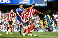 Chelsea Defender John Terry (26) puts pressure on Sunderland Defender Joleon Lescott (15) to clear during the Premier League match between Chelsea and Sunderland at Stamford Bridge, London, England on 21 May 2017. Photo by Andy Walter.