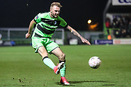 Forest Green Rovers Carl Winchester(7) crosses the ball during the The FA Cup 1st round replay match between Forest Green Rovers and Oxford United at the New Lawn, Forest Green, United Kingdom on 20 November 2018.
