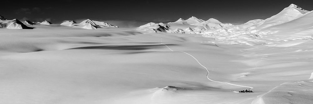 A snow scooter group takes a rest during their travel over of the untouched snow surface of Fridtjovbreen on Svalbard. Placed 18 in Epson International Pano Awards 2014.