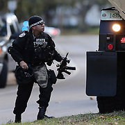Law enforcement officers are seen as they search for suspect Markeith Loyd at the Tzadik Brookside Apartments on January 9 2017 in Orlando, Florida. Loyd shot an Orlando Police officer earlier in the day at a local Walmart, the officer has since died.  (Alex Menendez via AP)