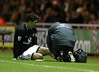 The FA Barclays Premiership<br />1 January 2005, The Riverside, Stadium, Middlesbrough<br />Middlesbrough v Manchester United<br />Manchester United's Cristiano Ronaldo recieves treatment following a challenge from Middlesbrough's Ray Parlour<br />Pic Jason Cairnduff/Back Page Images