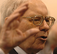 5/5/07 Omaha NE  Warren Buffett answers questions on the floor at Qwest Center Omaha just before the start of the Berkshire Hathaway annual meeting Saturday morning...(photo by Chris Machian/Prarie Pixel Group).