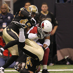 16 January 2010:  New Orleans Saints safety Darren Sharper (42) and cornerback Jabari Greer (32) break up a pass intended for Arizona Cardinals wide receiver Larry Fitzgerald (11) during a 45-14 win by the New Orleans Saints over the Arizona Cardinals in a 2010 NFC Divisional Playoff game at the Louisiana Superdome in New Orleans, Louisiana.