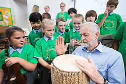 © Licensed to London News Pictures . 27/09/2016 . Liverpool , UK . Labour Party leader JEREMY CORBYN visits Faith Primary School in Liverpool , where he listens to and then joins in with the school orchestra . Photo credit : Joel Goodman/LNP