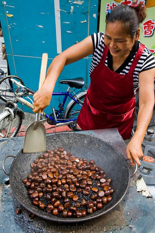 A vendor prepares a dish at an open air food stall in Taipei, Taiwan.