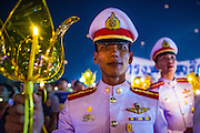 05 DECEMBER 2012 - BANGKOK, THAILAND:  Thai military cadets participate in the candle light vigil during the public ceremony to celebrate the birthday of Bhumibol Adulyadej, the King of Thailand, on Sanam Luang, a vast public space in front of the Grand Palace in Bangkok Wednesday night. The King celebrated his 85th birthday Wednesday and hundreds of thousands of Thais attended the day long celebration around the Grand Palace and the Royal Plaza, north of the Palace. The Thai monarch is revered by most Thais as unifying force in Thailand's society, which is not yet recovered from the political violence of 2010.     PHOTO BY JACK KURTZ