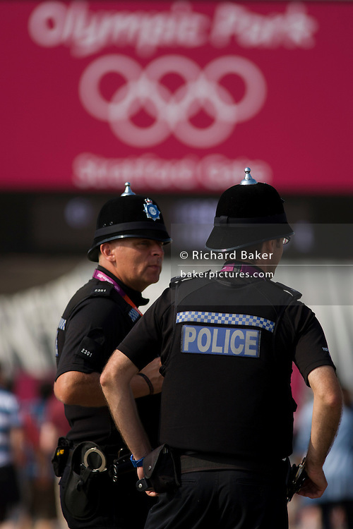 "Police officers from Humberside in the North east of England stand in front of the main entrance to the Olympic Park as a visible presence during the London 2012 Olympics. More than 230 officers from across the Humber region travelled to London to help police the Olympic Games. Holidays were restricted, training reduced and special constables  drafted in to provide cover in Hull and the East Riding as officers were sent to London to police the city while the Games are on. Senior officers say they have been working hard to ensure ""core policing"" across Hull and the East Riding is not weakened."