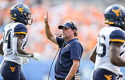 Sep 1, 2018; Charlotte, NC, USA; West Virginia Mountaineers head coach Dana Holgorsen stands along the sidelines during the second quarter against the Tennessee Volunteers at Bank of America Stadium. Mandatory Credit: Ben Queen-USA TODAY Sports