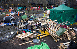 © Licensed to London News Pictures. 28/01/2021. London, UK. The remains of an HS2 Rebellion camp sits in Euston Square Gardens. Protestors are resisting a police operation to remove them for a second day. It is reported the protesters have built a 100ft tunnel under the gardens. Photo credit: Peter Macdiarmid/LNP