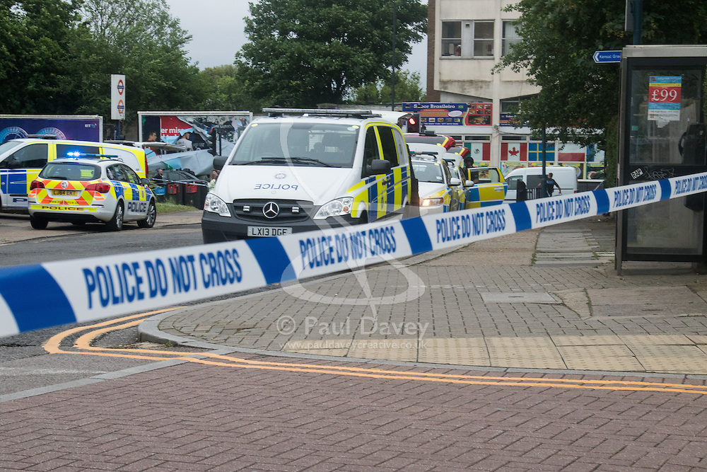 "Kensal Green, London, May 31st 2016. Armed police in body armoured protective headgear seal off Kensal Green tube and overground station in North West London in what is described as a ""security incident"". PICTURED: Police vehicles behind the cordon outside Kensal Green Tube station."