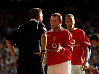 Photo: Jed Wee.<br />Manchester United v Blackburn Rovers. The Barclays Premiership. 24/09/2005.<br /><br />Manchester United's Wayne Rooney intervenes with referee Phil Dowd on Ruud van Nistelrooy's behalf as he goes tumbling in the box.