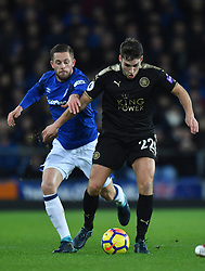 Everton's Gylfi Sigurdsson and Leicester City's Matty James compete for possession