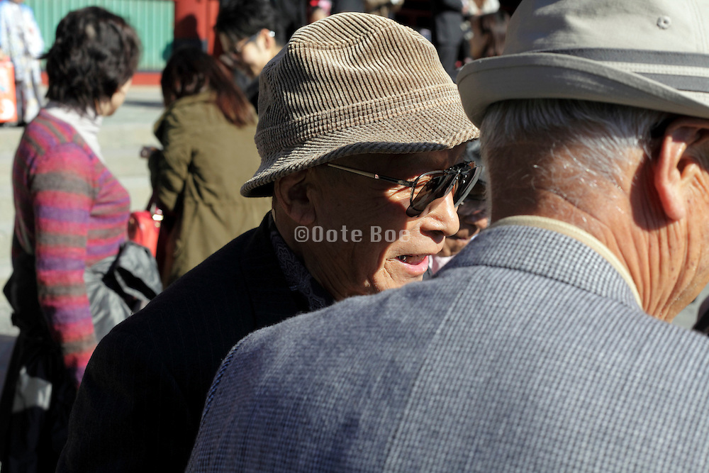 senior Japanese men during a day trip temple visit on a sunny day