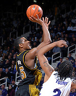 Missouri forward Marshall Brown (L) drives and scores over Kansas State's Blake Young (R), during the first half at Bramlage Coliseum in Manhattan, Kansas, January 31, 2007.  K-State beat the Tigers 80-73.