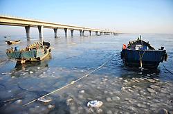 February 6, 2018 - Qingdao, China - Fishing boats can be seen at the partially frozen Jiaozhou Bay in Qingdao, east China's Shandong Province. (Credit Image: © SIPA Asia via ZUMA Wire)