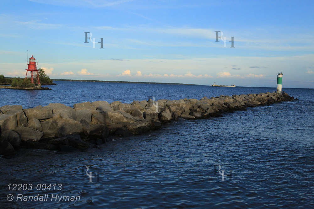 Breakwater and lighthouses frame Lake Huron on a September afternoon  in Alpena, Michigan.