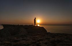 THEMENBILD - Silhouette eines Mannes am Strand des Mittelmeeres bei Sonnenaufgang an einem heissen Sommertag, aufgenommen am 17. August 2018 in Larnaka, Zypern // Silhouette of a man on the beach of the Mediterranean at sunrise on a hot summer Day, Larnaca, Cyprus on 2018/08/17. EXPA Pictures © 2018, PhotoCredit: EXPA/ JFK