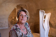 The sculptor Margherita Serra among her works in her gallery in the Sasso Caveoso, near which she lives