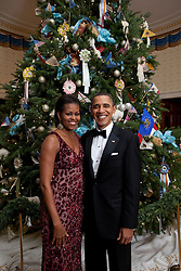 Dec. 5, 2010 - Washington, District of Columbia, U.S. - President BARACK OBAMA and First Lady MICHELLE OBAMA pose in front of the Official White House Christmas Tree in the Blue Room of the White House..(Credit Image: © Chuck Kennedy/The White House/ZUMAPRESS.com)