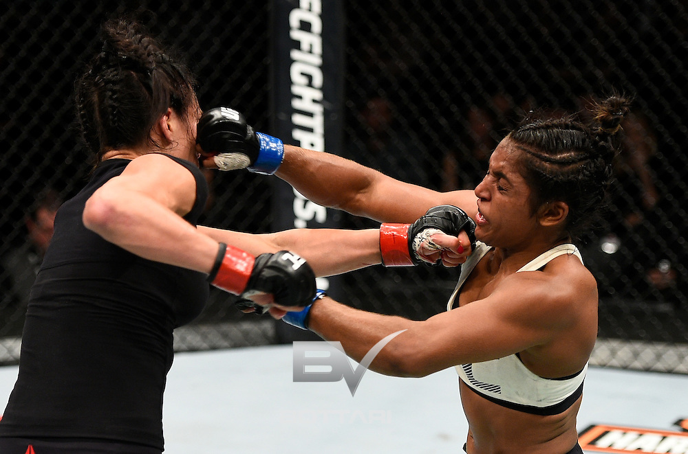 TORONTO, CANADA - DECEMBER 10:  (R-L) Viviane Pereira of Brazil punches Valerie Letourneau of Canada in their women's strawweight bout during the UFC 206 event inside the Air Canada Centre on December 10, 2016 in Toronto, Ontario, Canada. (Photo by Jeff Bottari/Zuffa LLC/Zuffa LLC via Getty Images)