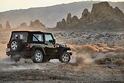 California automotive photographer Raymond Rudolph photographs a Jeep Wrangler off-roading in the desert through the Trona Pinnacles