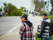"18 MAY 2020 - DES MOINES, IOWA: Men who participated in an anti-vaccine prayer vigil walk back to their truck. About eight adults, and their children, gathered in the front of the Iowa State Capitol in Des Moines Monday for a prayer vigil against mandatory vaccines. Iowa state law allows the governor to mandate vaccines for communicable diseases during a public health emergency and the ""anti-vaxxers"" are afraid the government will mandate a vaccine for Coronavirus (SAR-CoV-2) if one is developed. As of May 18, 355 people in Iowa have died from COVID-19, the disease caused by the Coronavirus (SARS-CoV-2), and 14,955 have tested positive for the Coronavirus.               PHOTO BY JACK KURTZ"