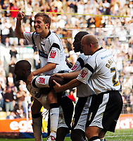 Photo: Kevin Poolman.<br />Derby County v Southend United. Coca Cola Championship. 30/09/2006. Michael Johnson (Derby) celebrates his goal with Arturo Lupoli on his back.