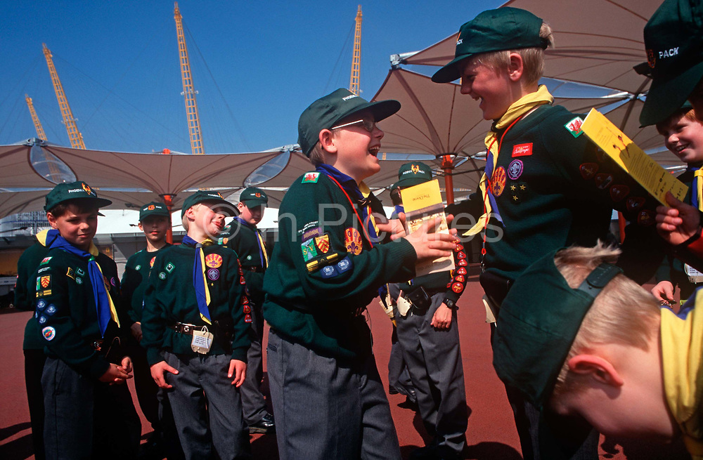 A pack of cub scouts enjoy a day out visiting the Greenwich Peninsular where The Millennium Dome later to become the 02 Arena is being constructed, on 25th March 1998, in London, England.