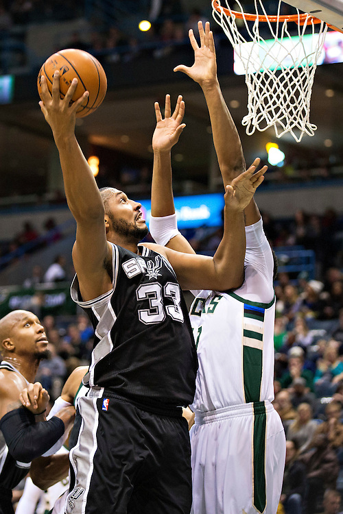 """MILWAUKEE, WI- JANUARY 4:  Boris Diaw #33 of the San Antonio Spurs shoots a hook shot against John Henson #31 of the Milwaukee Bucks at BMO Harris Bradley Center on January 4, 2016 in Milwaukee, Wisconsin.  """"NOTE TO USER: User expressly acknowledges and agrees that, by downloading and or using this photograph, User is consenting to the terms and conditions of the Getty Images License Agreement.""""(Photo by Wesley Hitt/Getty Images) *** Local Caption *** John Henson; Boris Diaw"""