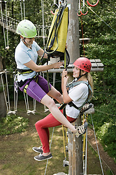female teenager and a young female instructor in a climbing crag
