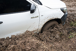 A vehicle of COCASJOL coffee coop got stuck in the mud on a routine visit to a farm. Access to farms has become increasingly difficult with many major and minor roads incapacitated.
