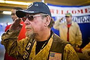 04 FEBRUARY 2011 - PHOENIX, AZ: DAVID STRASSHOFER, a veteran of the US Marine Corps, salutes during the presentation of the colors at the Arizona StandDown in Phoenix Friday. The Arizona StandDown is an annual three day event that brings together the Valley's homeless and at-risk military veterans, connecting them with services ranging from: VA HealthCare, mental health services, clothing, meals, emergency shelter, transitional and permanent housing, ID/ drivers license's, court services and Legal Aide, showers, haircuts and myriad other services and resources.  Arizona StandDown is held annually at the Veterans Memorial Coliseum at the Arizona State Fairgrounds in Phoenix on Super Bowl weekend.    Photo by Jack Kurtz