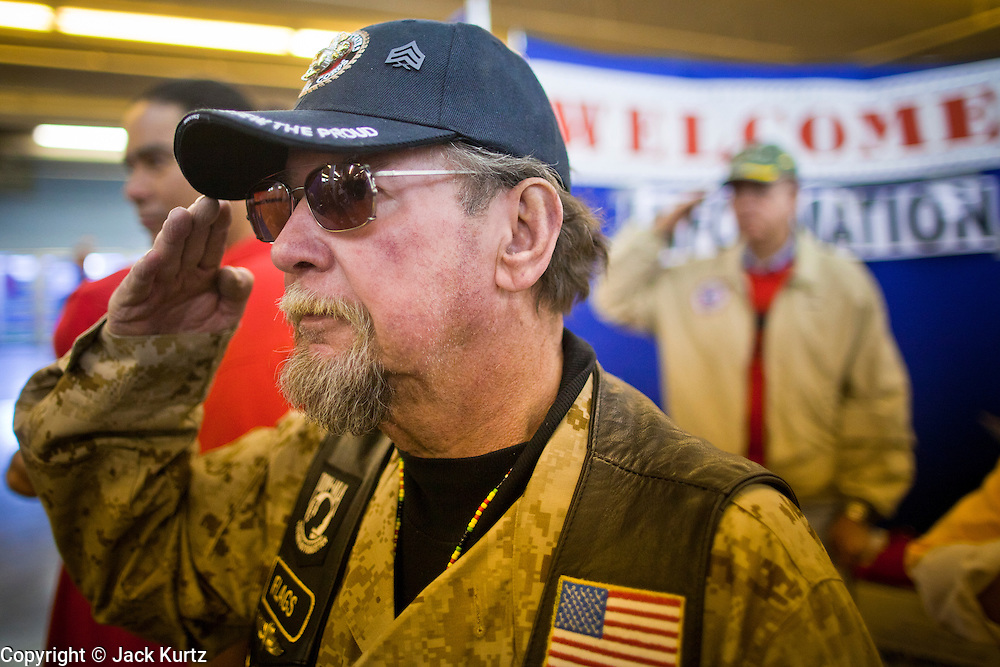 04 FEBRUARY 2011 - PHOENIX, AZ: DAVID STRASSHOFER, a veteran of the US Marine Corps, salutes during the presentation of the colors at the Arizona StandDown in Phoenix Friday. The ArizonaStandDown is an annualthree day event that brings together the Valley's homeless and at-risk military veterans, connecting themwith services ranging from: VA HealthCare, mental health services, clothing, meals, emergency shelter, transitional and permanent housing,ID/ drivers license's, court services and Legal Aide, showers, haircuts and myriad other services and resources. Arizona StandDown isheld annually at theVeterans Memorial Coliseum at the Arizona State Fairgrounds in Phoenixon Super Bowl weekend.    Photo by Jack Kurtz