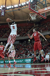 15 February 2014:  The rebound bounces the way of Jamaal Samuel instead of Jordan Prosser during an NCAA Missouri Valley Conference (MVC) mens basketball game between the Bradley Braves and the Illinois State Redbirds  in Redbird Arena, Normal IL.
