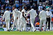 Virat Kohli (captain) of India congratulating his team on a good morning session as they go off for lunch during the first day of the 4th SpecSavers International Test Match 2018 match between England and India at the Ageas Bowl, Southampton, United Kingdom on 30 August 2018.