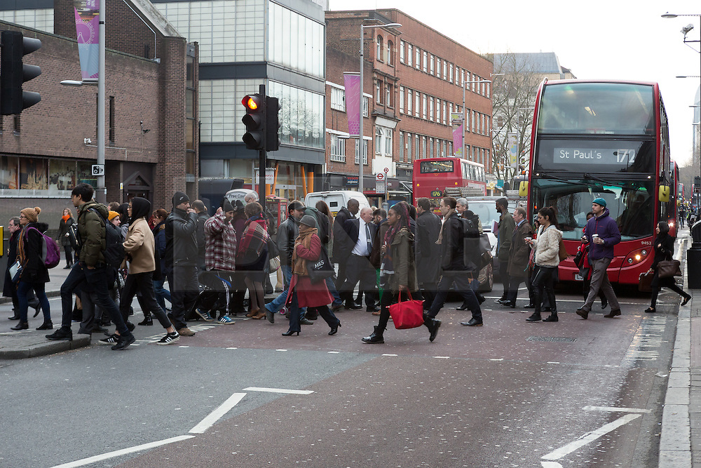 """© Licensed to London News Pictures. 18/01/2016. London, UK. Commuters cross the road outside Waterloo Station this morning. Today, known as """"Blue Monday"""" is meant to be the most depressing day of the year. Photo credit : Vickie Flores/LNP"""