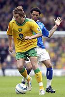 Fotball<br /> England 2004/2005<br /> Foto: SBI/Digitalsport<br /> NORWAY ONLY<br /> <br /> Norwich v Birmingham<br /> FA Barclays Premiership<br /> 07/05/2005<br /> <br /> Norwich's Darren Huckerby gets past Birmingham's Jermaine Pennant