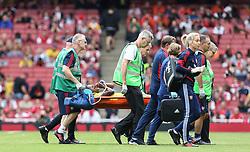Danielle Carter of Arsenal is stretchered off - Mandatory by-line: Arron Gent/JMP - 28/07/2019 - FOOTBALL - Emirates Stadium - London, England - Arsenal Women v Bayern Munich Women - Emirates Cup