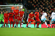 Dimitri Payet of West Ham United (r)  takes a free kick and scores his teams 1st goal. Premier League match, Liverpool v West Ham Utd at the Anfield stadium in Liverpool, Merseyside on Sunday 11th December 2016.<br /> pic by Chris Stading, Andrew Orchard sports photography.