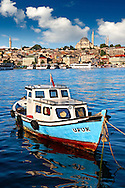 Fishing boat in the Golden Horn on the Galata banks looking towards the Suleymaniye Mosque (Süleymaniye Camii, 1550-1558)  on the Third Hill, Istanbul Turkey. .<br /> <br /> If you prefer to buy from our ALAMY PHOTO LIBRARY  Collection visit : https://www.alamy.com/portfolio/paul-williams-funkystock/istanbul.html<br /> <br /> Visit our TURKEY PHOTO COLLECTIONS for more photos to download or buy as wall art prints https://funkystock.photoshelter.com/gallery-collection/3f-Pictures-of-Turkey-Turkey-Photos-Images-Fotos/C0000U.hJWkZxAbg