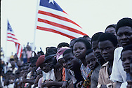 Crowds watch President Carter during a parade in Monrovia, Liberia. President Tolbert is with  Carter in the limo.<br /> Photo by Dennis Brack