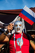 Moscow, Russia, 16/06/2018.<br /> A Mexico supporter in a wrestling mask waves a Russian flag in central Moscow during the 2018 FIFA World Cup.