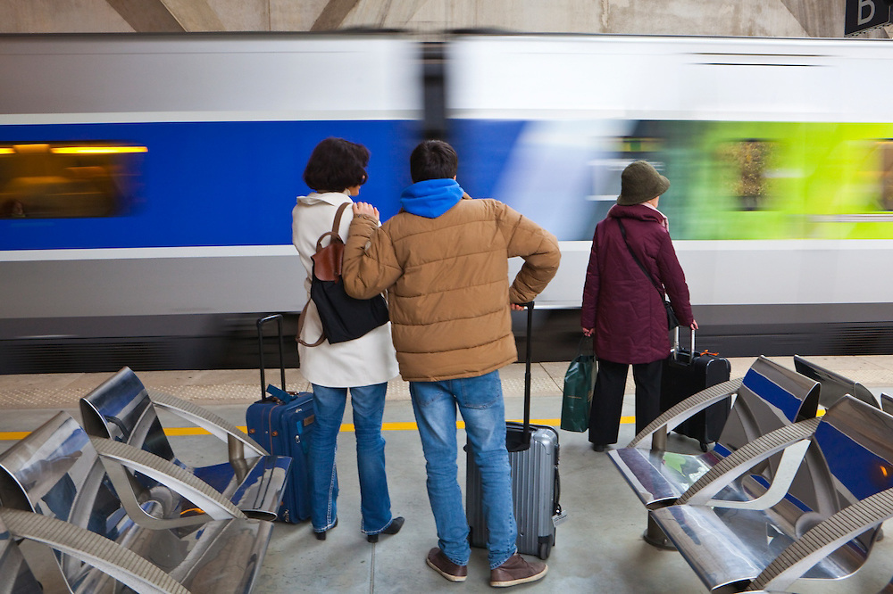 Passengers prepare to board a TGV train at the Saint-Exupéry airport railway station in Lyon, France.