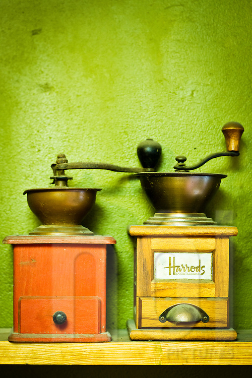 Decorations and coffee grinders on display at Cat Cafe in Hanoi, Vietnam, Asia