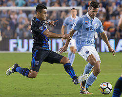 August 9, 2017 - Kansas City, Kansas, U.S - San Jose Earthquakes midfielder Darwin Ceren #17 (l) makes a defensive tackle against Sporting KC midfielder Benny Feilhaber #10 (r) during the first half of the game. (Credit Image: © Serena S.Y. Hsu via ZUMA Wire)