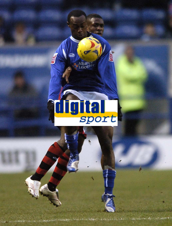 Photo: Jonathan Butler.<br />Leicester City v Cardiff City. Coca Cola Championship. 23/12/2006.<br />Elvis Hammond of Leicester holds off the Cardiff defender.