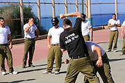 "Soldiers train with Krav Maga (""contact combat"", ""close combat"" or ""full contact"") is an eclectic hand-to-hand combat system developed in Israel that involves wrestling, grappling and striking techniques) at an Israeli military training camp."