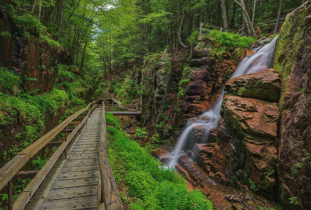 New England photography of the Flume Gorge and Avalanche Falls in the Franconia Notch State Park and New Hampshire White Mountains.<br /> <br /> Beautiful New England nature photography photos of the New Hampshire Flume Gorge boardwalk and Avalanche Falls are available as museum quality photography prints, canvas prints, acrylic prints, wood prints or metal prints. Fine art prints may be framed and matted to the individual liking and interior design decorating needs.<br /> <br /> Good light and happy photo making!<br /> <br /> My best,<br /> <br /> Juergen