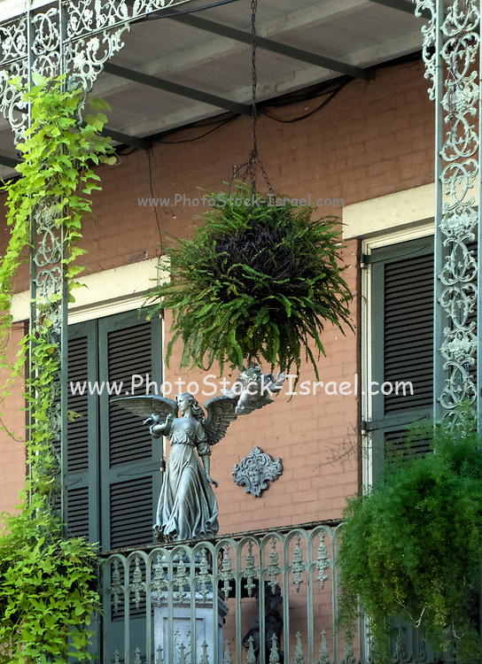 Street in French Quarter in Downtown New Orleans, Louisiana, United States, with its typical balconies and iron railings,